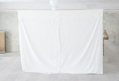 Projection screen in rural settings, blank white canvas. Old time stock photo