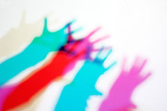 Projection of several hands of people. In front of a large spotlight stock photos