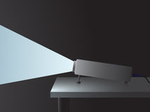 Projector with a beam. Light plastic projector with a beam on a table Stock Image