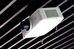 Projector on ceiling. Ceiling mounted projector for commercial use Stock Photos