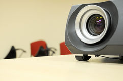 Projector closeup. Over classroom background Royalty Free Stock Image