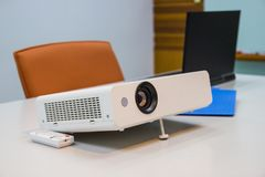 Projector connected to Laptop. On for  presentation in a meeting room, business concept Stock Images