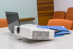 Projector connected to Laptop on for presentation in a meeting room Royalty Free Stock Photography