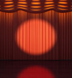 Projector directed on a red curtain Stock Photo