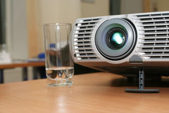 Projector with glass at office table (horizontal) Stock Photo