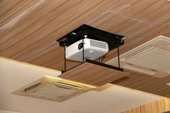 Projector hanging on meeting room ceiling stock photos