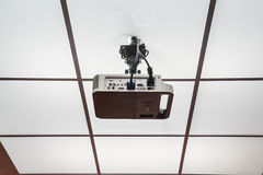 Projector installed on the ceiling. Close up modern multimedia projector hanging on ceiling royalty free stock photo