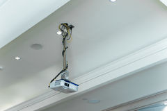 Projector installed on the ceiling in meeting room. Projector installed on the ceiling royalty free stock photo