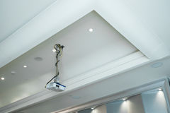 Projector installed on the ceiling  in meeting room Stock Photo