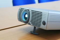 Projector at office table Stock Photo