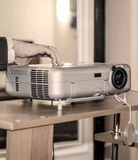 Projector on office table Stock Photos