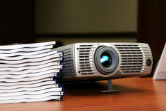 Projector with pile of books. On the table #3 Royalty Free Stock Photos