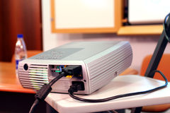 Projector on presentation. Projector on table ready for presentation Stock Photography