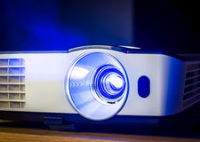Projector for presentation. Closeup of projector for presentation in blue light tone royalty free stock photo