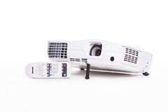 Projector with remote control. Full Hd resolution projector for presentations and conferences stock photo
