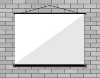 Projector screen on brick wall, Stock Image
