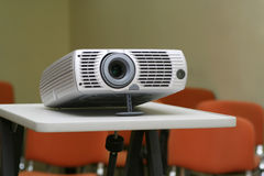 Projector on stand ready for presentation at office. With chairs behind in empty hall #1 Stock Photography