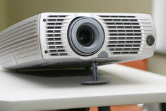 Projector on stand ready for presentation at office. With chairs behind in empty hall #2 Royalty Free Stock Photo