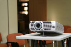 Projector on stand ready for presentation at office. With chairs behind in empty hall #3 Stock Images