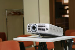 Projector on stand ready for presentation at office Royalty Free Stock Image