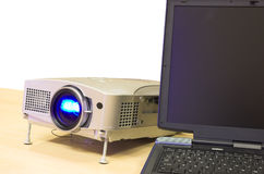 Projector on the table. Presentation equipment - notebook and attached projector Royalty Free Stock Image