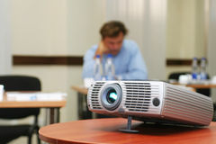 Projector on table with person behind (horizontal) Stock Images