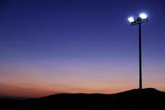 Projectores no pôr-do-sol Fotografia de Stock Royalty Free