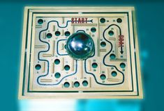 Projects becomes too big for the goal, Labyrinth, board games. Projects that have become too big, the goal therefore difficult to reach. The ball is stuck stock images