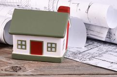 Projects of houses with model of a house Stock Photography