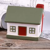 Projects of houses with model of a house Stock Photos