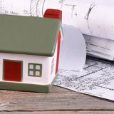 Projects of houses with model of a house Stock Photo