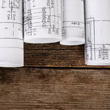 Projects of houses on wooden background Stock Photo