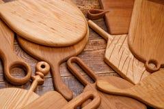 Projekt deski robić stały drewno Set tnące deski na drewnianym tle Obraz Royalty Free