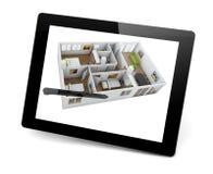 Projetando uma casa em um PC da tabuleta ilustração stock