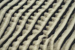 Projeto abstrato na areia Fotos de Stock