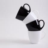 Projeto de quatro canecas de café Fotos de Stock Royalty Free