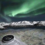 Projeto Desaturated com aurora boreal, fiordes, mapa e compas Fotos de Stock Royalty Free