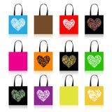 Projeto dos sacos de compra, forma floral do coração Fotografia de Stock