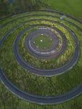 Projeto espiral bonito em um campo verde fotografia de stock royalty free
