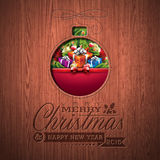 Projeto tipográfico do Feliz Natal gravado e do ano novo feliz com elementos do feriado no fundo de madeira da textura