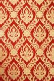 Projeto vermelho da deidade do teste padrão da parede tailandesa da arte Fotos de Stock Royalty Free