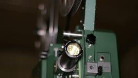 Projetor de filme que projeta o foco da cremalheira do filme de 16mm