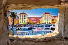 Prokurative square in Split through stone window Stock Images