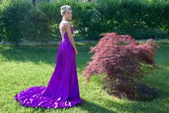 Prom. Teenager in purple prom dress Royalty Free Stock Photos