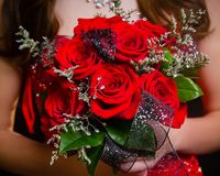 Prom bouquet Red roses. Close up of red rose prom bouquet with coordinating ribbon stock images