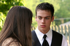 Prom Boy & Date's Mother 2. Prom boy listening to his date's mother intently in an outdoor setting stock photo
