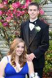 Prom Couple Portrait with Girl Sitting Stock Photo