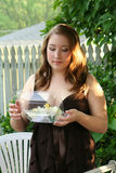 Prom Girl Looking At Corsage Stock Photo