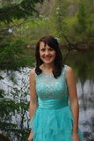 Prom. Image of a girl in her prom dress by a pond Stock Image