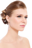Prom make-up and hairdo. Young beautiful blond girl with prom make-up and hairdo, over white background royalty free stock photography